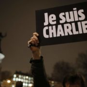 "A man holds a placard which reads ""I am Charlie"" to pay tribute during a gathering at the Place de la Republique in Paris January 7, 2015, following a shooting by gunmen at the offices of the magazine. Gunmen stormed the Paris offices of the weekly satirical magazine Charlie Hebdo, renowned for lampooning radical Islam, killing at least 12 people, including two police officers in the worst militant attack on French soil in recent decades. The French President headed to the scene of the attack and the government said it was raising France's security level to the highest notch.          REUTERS/Christian Hartmann (FRANCE  - Tags: CRIME LAW MEDIA) - RTR4KFYM"